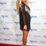 Aubrey O'Day Wearing a Swimsuit at The Hard Rock Hotel in Las Vegas - June 17, 2012  - 01