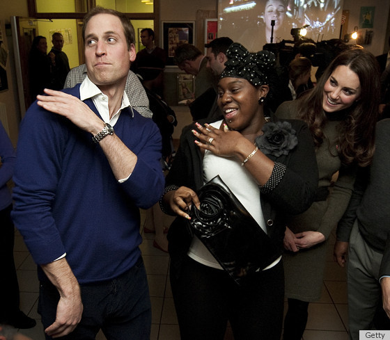Prince William Brushing his shoulder off