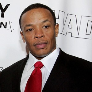 Dr dre in a suit complete with white shir and power tie. Executive producer of Fx show