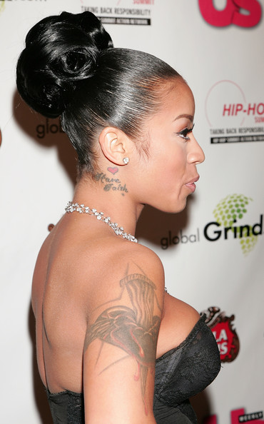Keyshia Cole's Tattoo a Heart with a stake in it