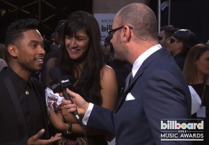 Miguel backstage at the billboard music awards
