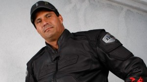 Jose Cansco poses in a black motorcycle jacket