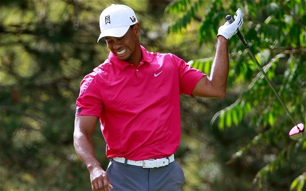LAKE FOREST, IL - SEPTEMBER 14: Tiger Woods reacts on the 15th tee after hitting a shot into the water during the Third Round of the BMW Championship at Conway Farms Golf Club on September 14, 2013 in Lake Forest, Illinois. (Photo by Sam Greenwood/Getty Images)